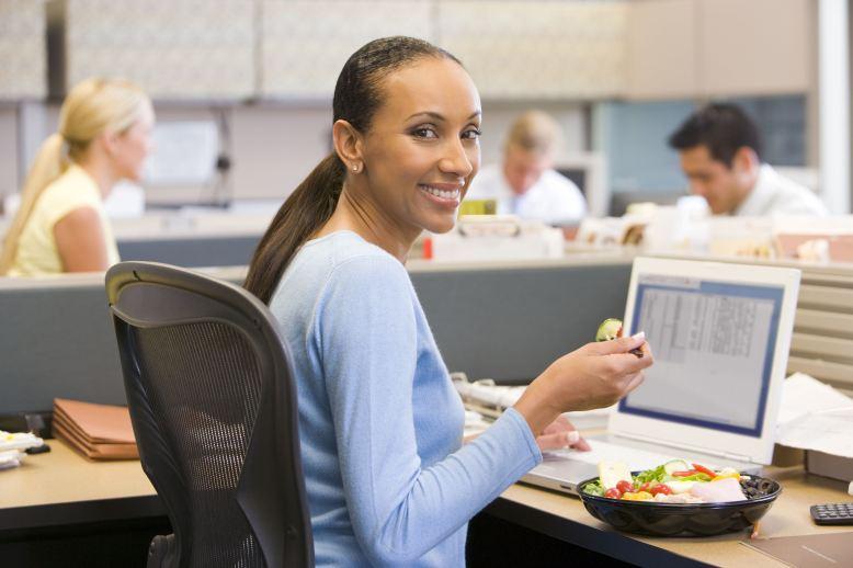 website image business woman eating salad