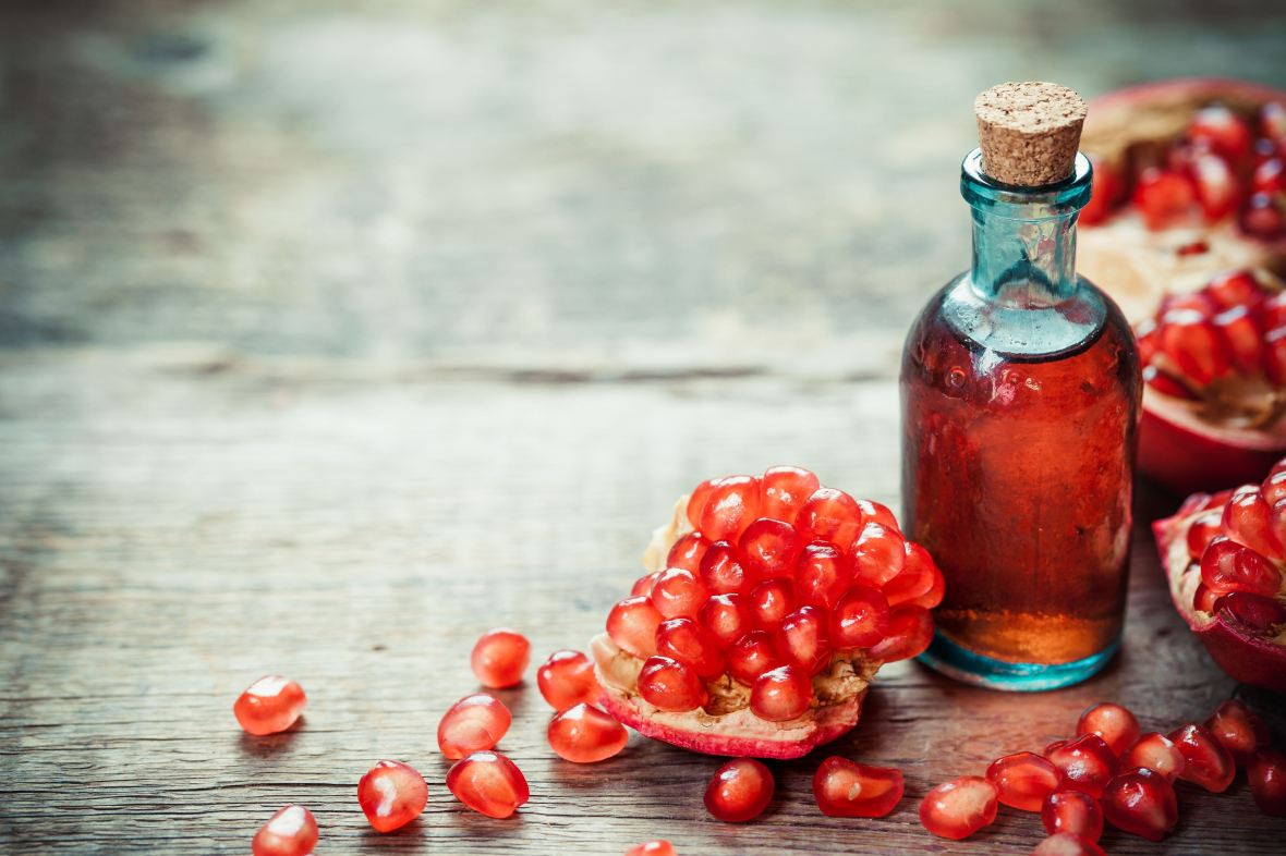 website image pomegranate and glass bottle